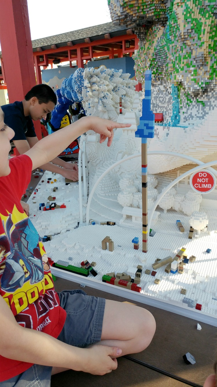 Adding your own creations to existing displays is encouraged at LEGOLAND Hotel