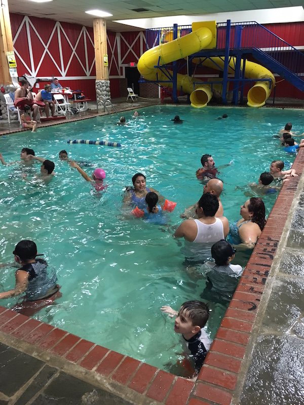 Families at Pinegrove Family Dude Ranch splash and swim indoors.