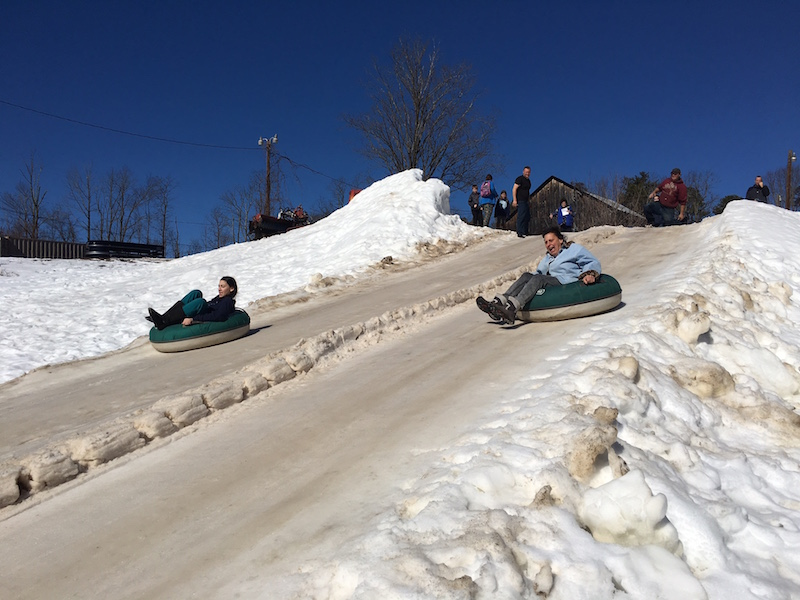 Grab a snow tube and hit the slope at Pinegrove Family Dude ranch in the winter.
