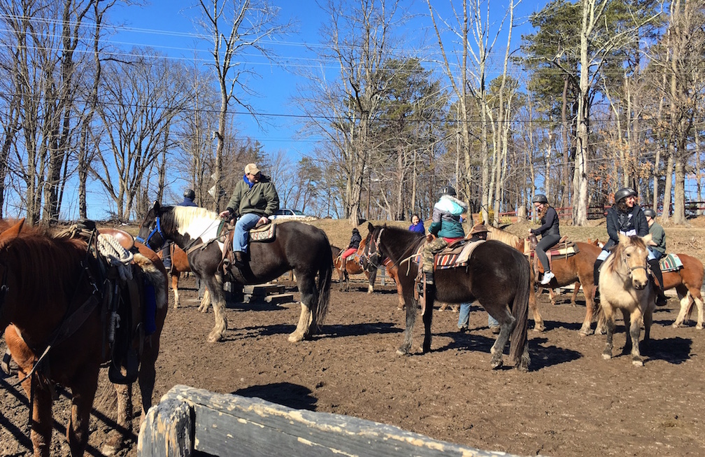 Riders at Pinegrove Family Dude Ranch get ready to hit the trails on horseback.