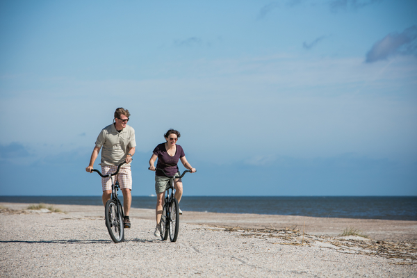 Riding bikes on the beach is one of the best free things to do with kids on Amelia Island