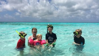 Grand Cayman Island is a slice of Caribbean paradise. Swim with stingrays, snorkel above coral reefs, jet ski, and more family activities in Grand Cayman.