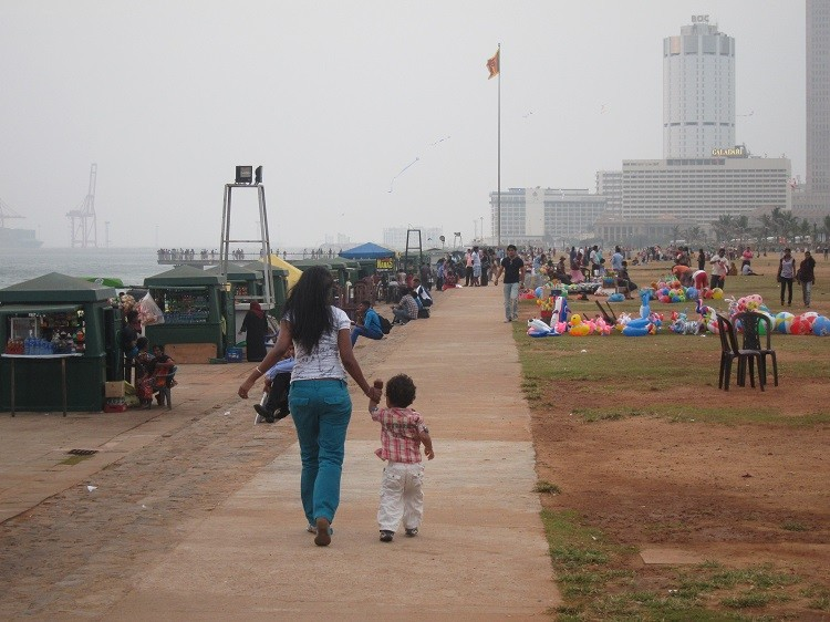 Mother and child enjoy a promenade when visiting Colombo Sri Lanka with kids.