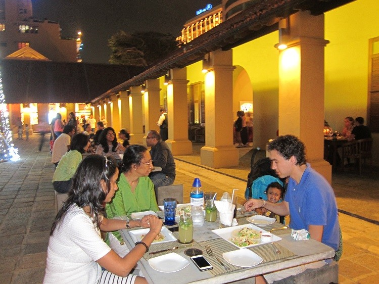 Outdoor family dining at Dutch Hospital, one of the 5 best things to do when visiting Colombo Sri Lanka with kids.