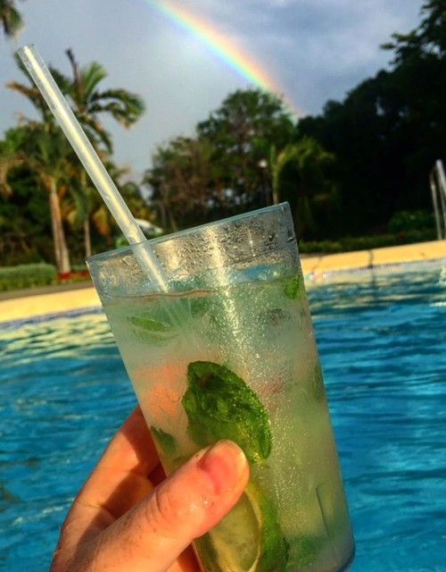 cocktail and rainbow at melia braco village, an all-inclusive jamaica resort