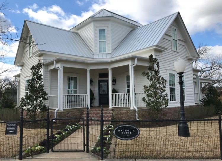 The exterior of HGTV fixer upper where fans will want to know how to book Magnolia House