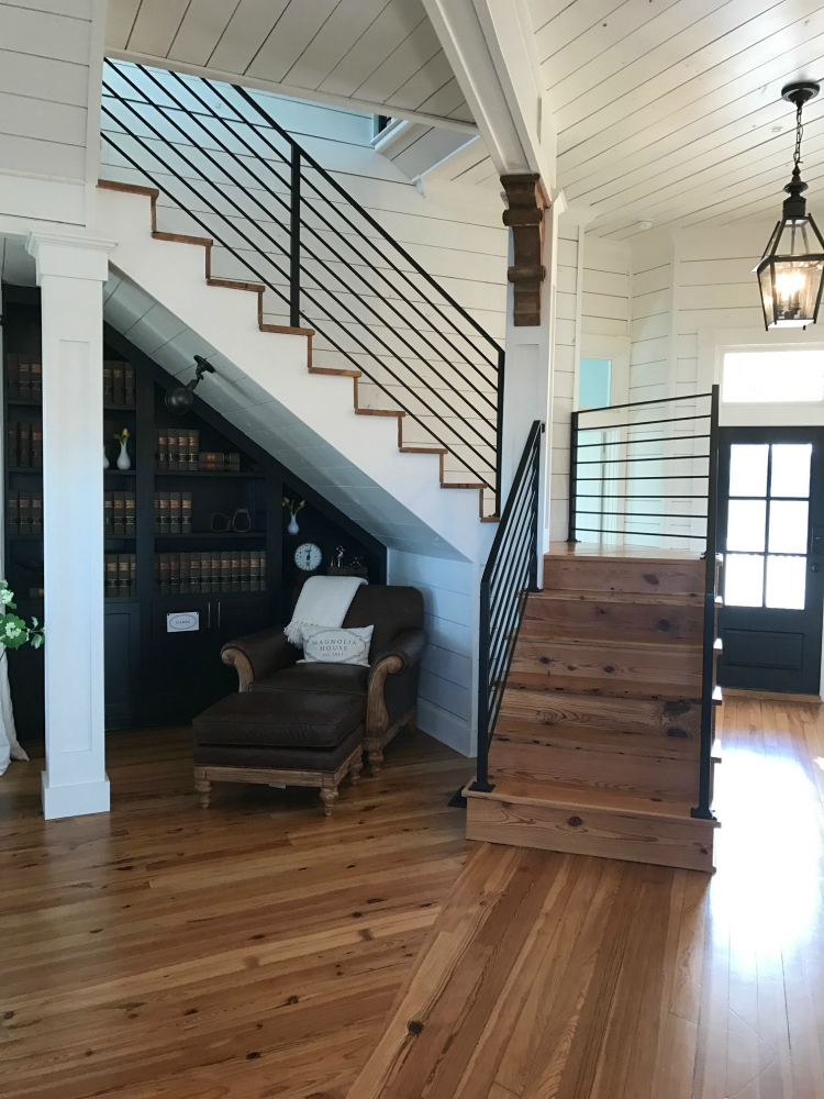 Book Magnolia House of HGTV Fixer Upper and curl up in this reading nook under the stairs