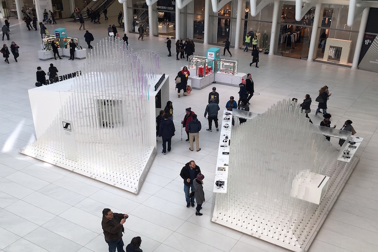 A view from the mezzanine in the World Trade Center Oculus hall reveals modern shopping kiosks.
