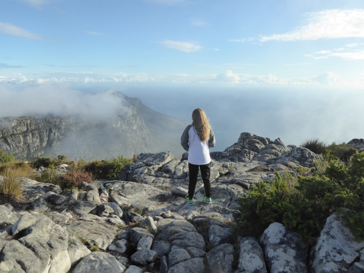 Standing atop Table Mountain, one of things to do with kids in Cape Town, South Africa,
