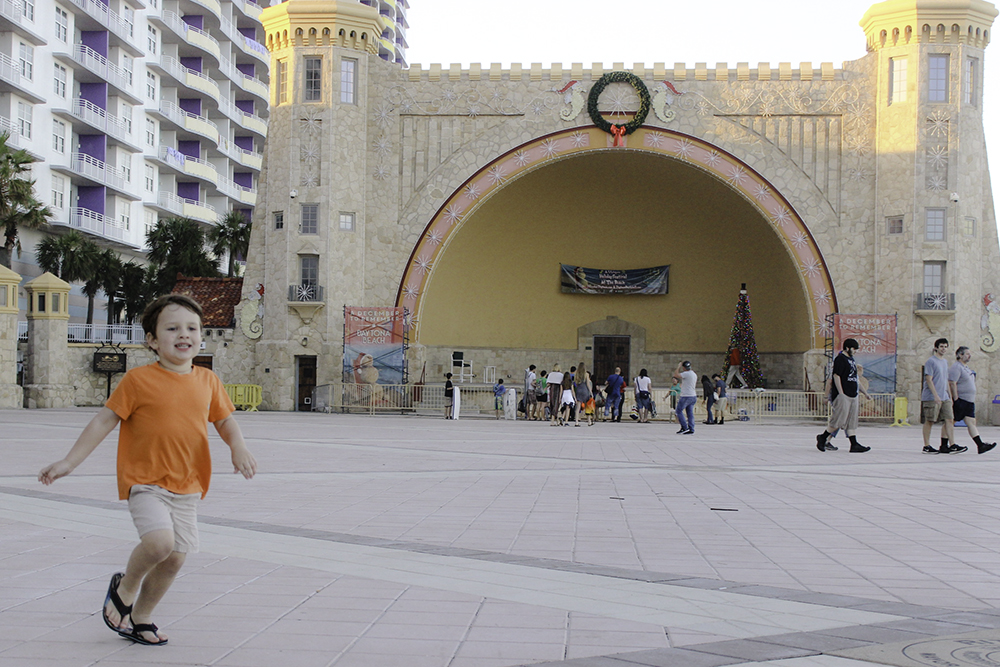 Running around the bandshell at the Ocean Walk Shoppes is fun for kids.