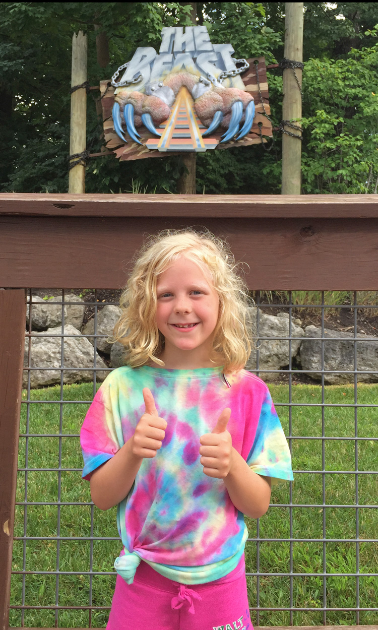 A young girl gives The Beast two thumbs up, but - despite on one of the Kings Island tips to do so - hasn't yet braved it at night.