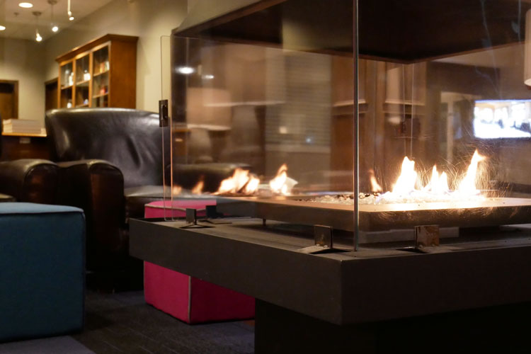 Spa Eastman lobby fireplace enjoyed during a wellness getaway where you can kickstart healthy habits