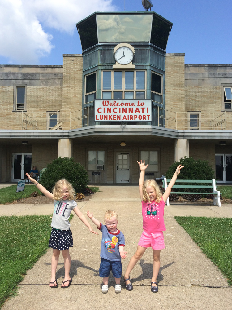 children stand outside of Lunken Airport, one of locals' favorite free Cincinnati activities, after watching the planes