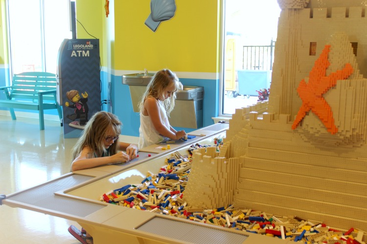 Kids love the giant LEGO table at Sandy's Castle Restaurant