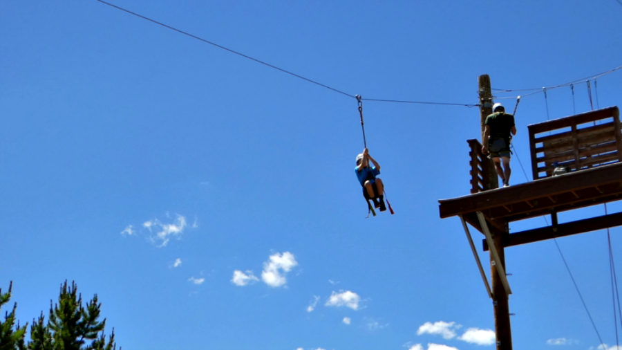 Soar through the air while zip lining at Colorado's YMCA Snow Mountain Ranch, one of many activites available.