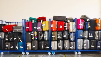 Stuffed luggage cart at the airport.