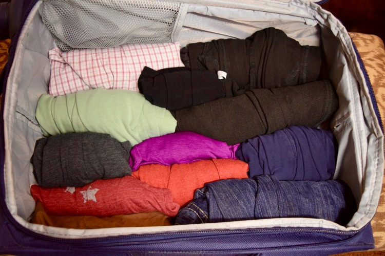 You can fit so much in your suitcase when you roll your clothes, a handy packing tip