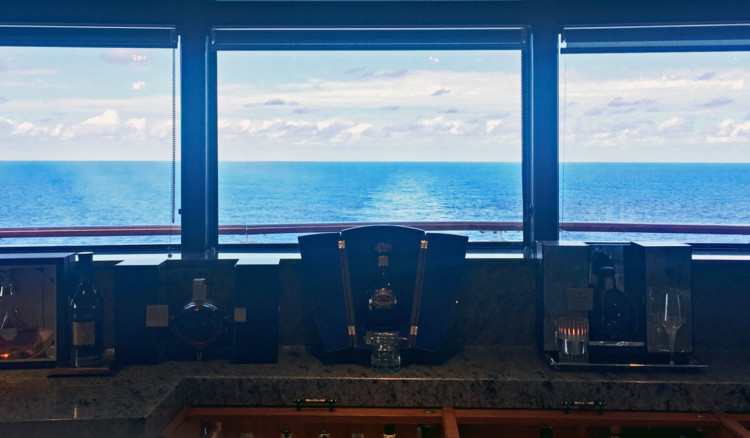Meridian lounge sets the tone before dining at nearby Palo on a Disney Cruise, with floor to ceiling glass windows overlooking the ocean
