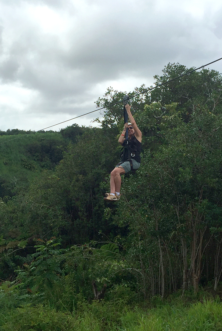 zip lining over huge waterfalls is among unique adventures on hawaii island