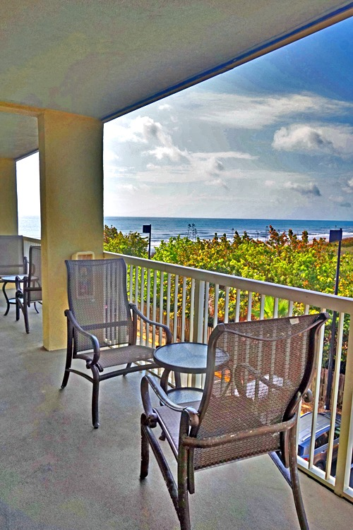 Enjoy the shade and the view right at your door - Crowne Plaza Melbourne-Oceanfront, a Florida beach hotel.