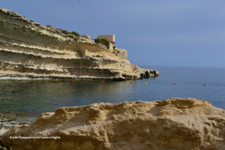 7 fabulous must see Malta beaches: Delimara Cove's weathered cliffs look like artwork.