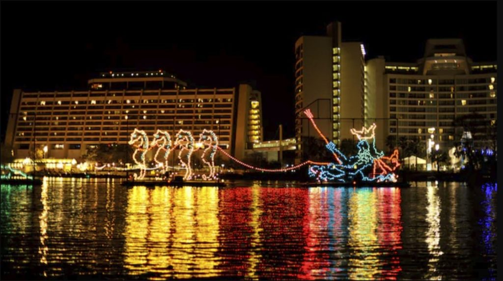 The Electrical Water Pageant, a nightly floating light parade on the Seven Seas Lagoon and Bay Lake outside Disney parks - TravelingMom