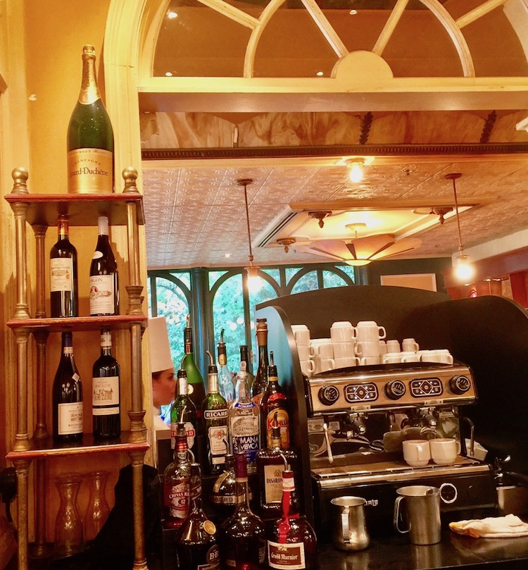 French dining at Disney includes a traditional looking bar--so not American.