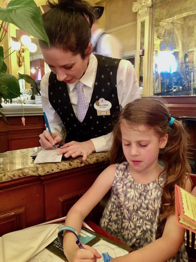 French dining at Disney involves servers as helpful as Cast members, and they speak perfect French!