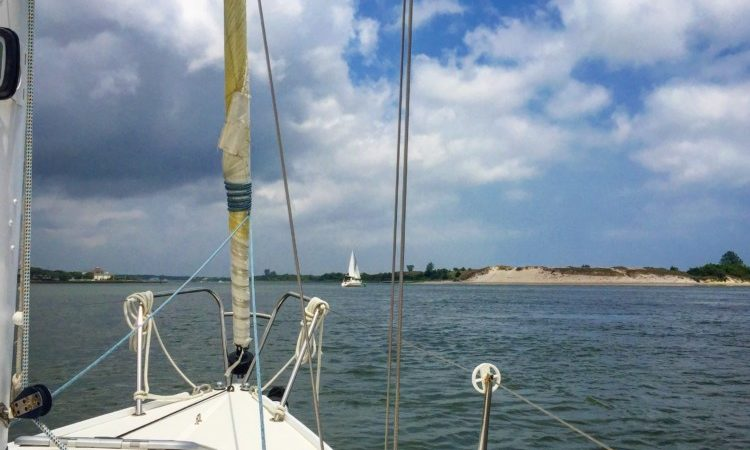 Family fun at beaches near Wilmington, North Carolina includes sailing