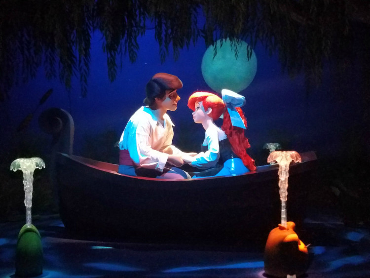 At the Magic Kingdom, toddlers enjoy an indoors ride watching the story of The Little Mermaid and Ariel's life unfold