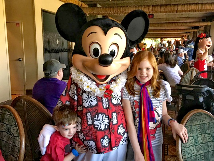 Mickey greets guests joining him for Disney character dining at 'Ohana