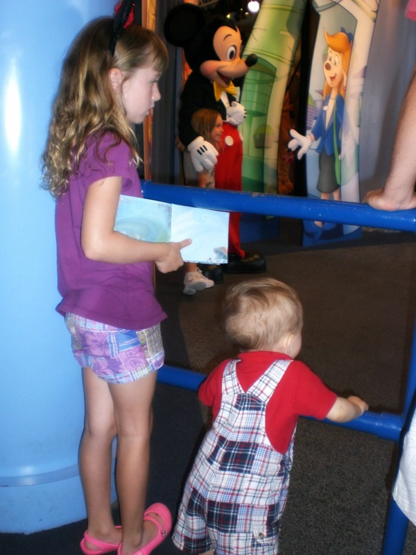 Should you wait to bring preschoolers to Disney World? My preschooler kids wait for their chance to meet Mickey Mouse at Disney World Epcot's Character Spot.