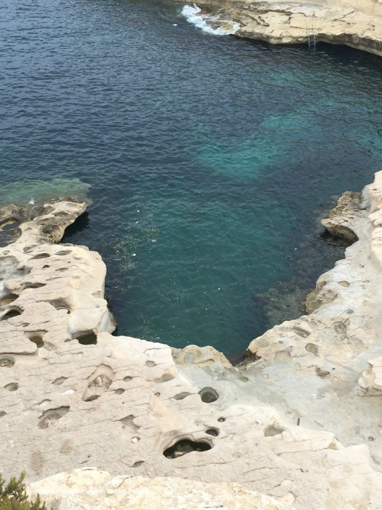7 fabulous must see Malta beaches: crystal clear aquamarine water of St. Peter's Pool.