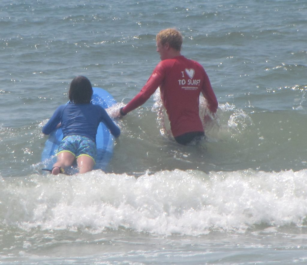 Learning to surf at Wilmington NC beaches.