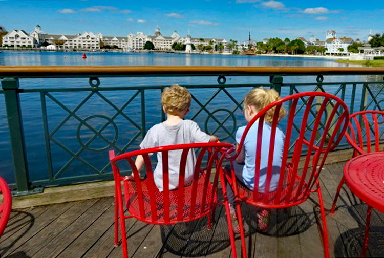 children sit on Disney's Boardwalk, a great place for families to hang out
