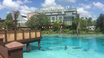 Disney Springs bottling company building adds to the atmosphere of the themed shopping area, which is full of high-end shopping experiences and stores for shoppers on a budget
