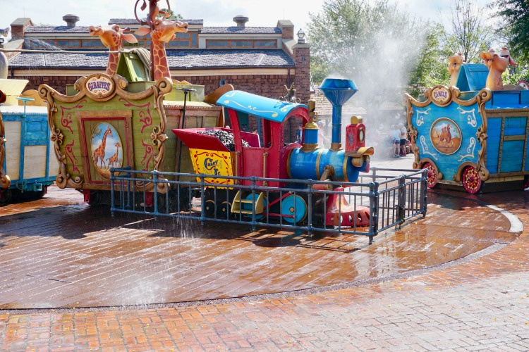 Taking breaks and allowing younger children to explore and burn off energy at play areas, like the Casey Jr. Splash 'N' Soak Station, is one of the fun things to do while waiting in line at Disney. Photo by Multidimensional TravelingMom, Kristi Mehes.