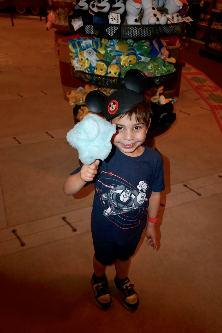 Munching on yummy snacks, like cotton candy, is also one of the fun things to do while waiting in line at Disney. Photo by Multidimensional TravelingMom, Kristi Mehes.
