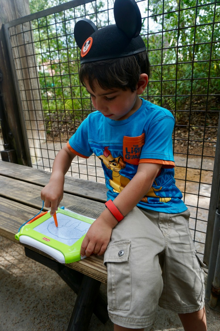 A drawing tablet is a lifesaver when traveling and one of the fun things to do while waiting in line at Disney. Photo by Multidimensional TravelingMom, Kristi Mehes.