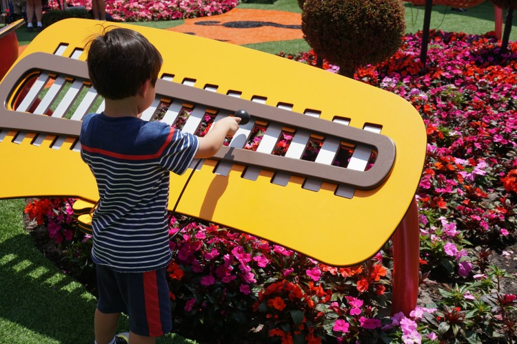 Taking breaks in play areas is one of the other fun things to do while waiting in line at Disney. This musical instrument in Epcot was a huge hit with my son. Photo by Multidimensional TravelingMom, Kristi Mehes.