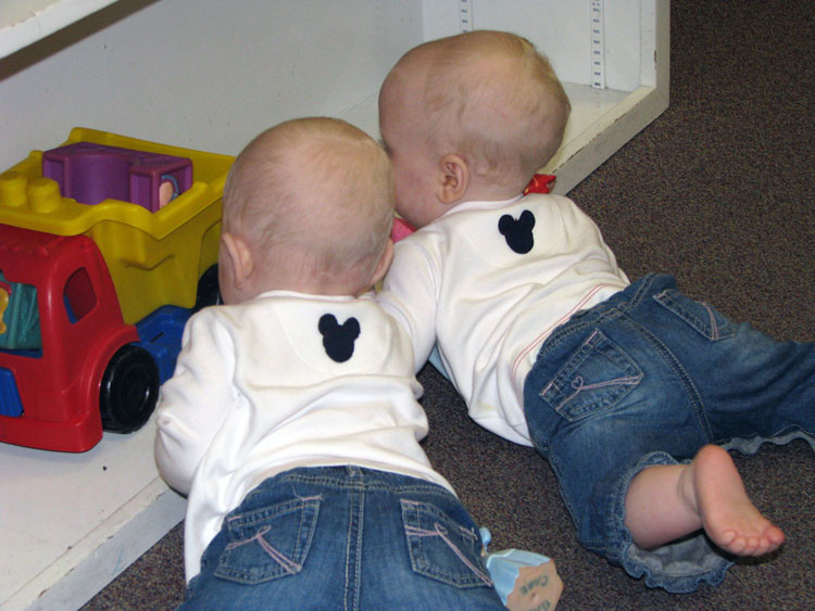 twin infants play with toys at Walt Disney World's Baby Care Center