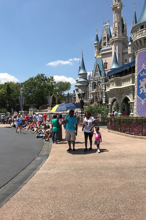 Take a break in the Magic Kingdom by stepping out of the midday heat in front of Cinderella's Castle.