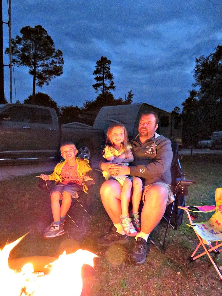 Gather round the campfire when families go travel trailer camping.