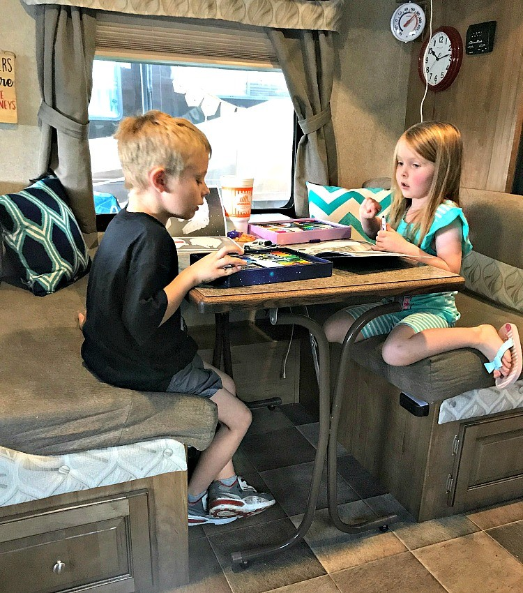 Game time is special time during a family travel trailer camping trip.