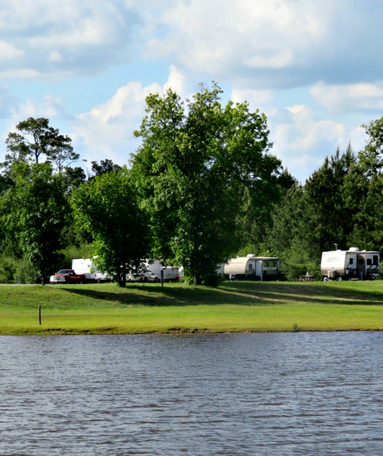 Families own the open road when they go travel trailer camping.