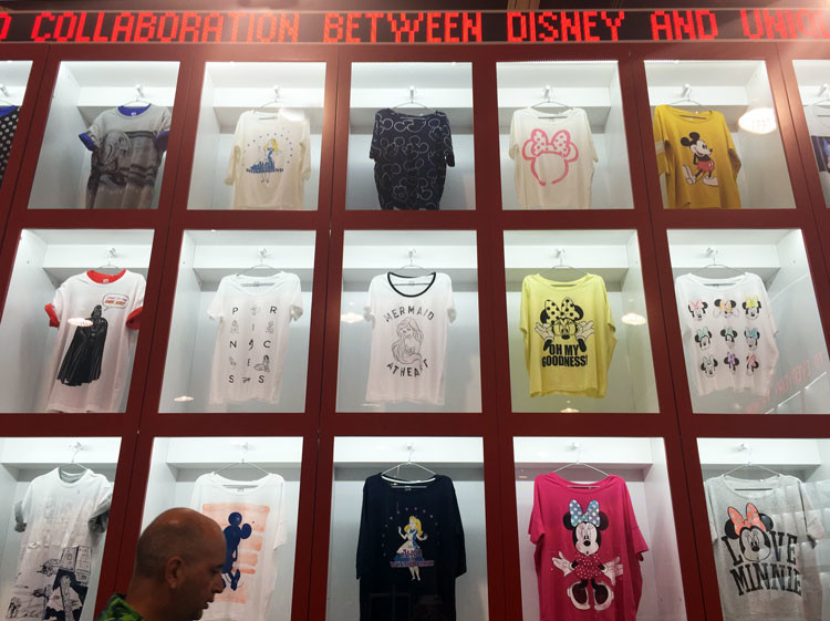 "A selection of shirts from the Uniqlo ""Disney Project"", a great choice for budget shopping at Disney Springs"