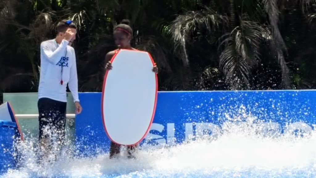 A teen tries the FLOWRIDER at the Boca Raton Resort, one of the best Florida resorts for families.