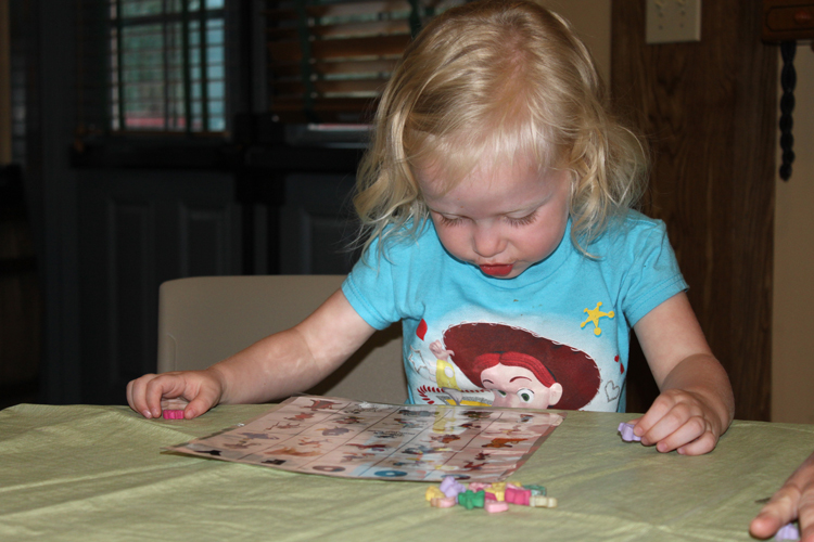young girl plays Goofy bingo, one of the activities included in the Disney resort on Hilton Head island