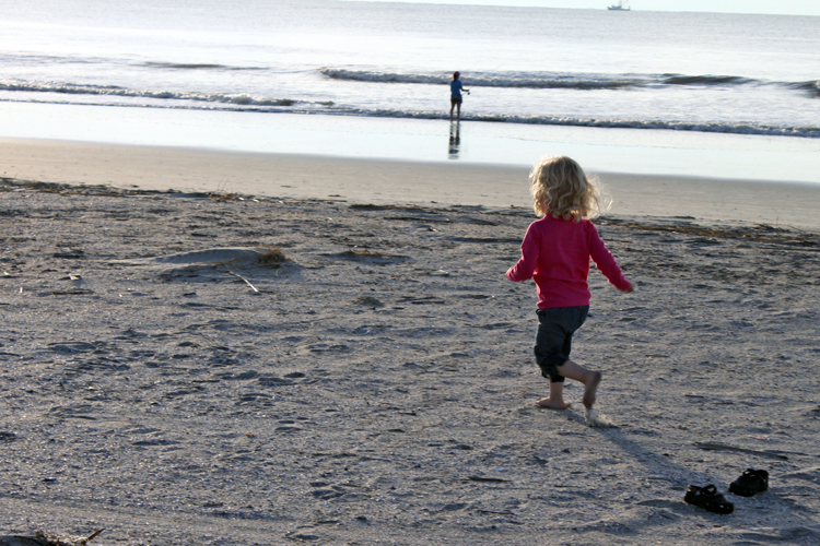 girl runs on a private beach at Disney's Hilton Head Island resort beach house