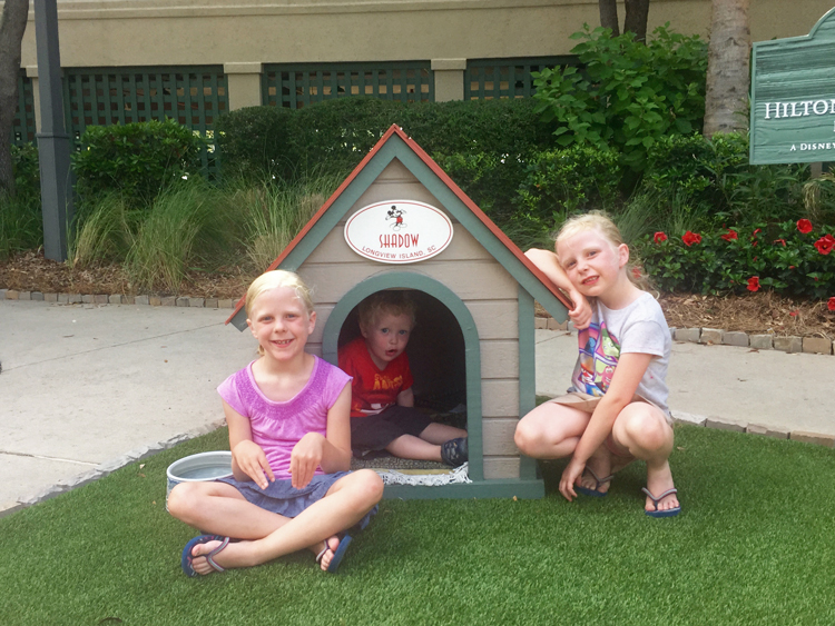Kids love to pose with Shadow's dog house at the Disney resort on Hilton Head Island